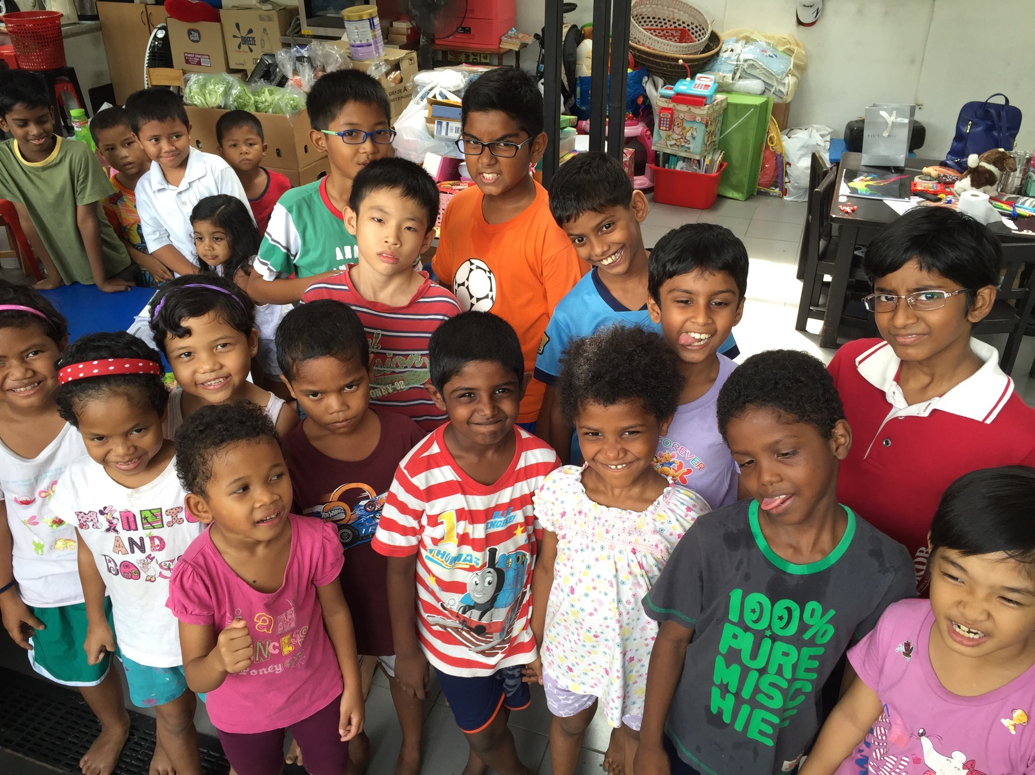Photo 2 - Children from local homes feeling happy after receiving their weekly deliveries.jpg