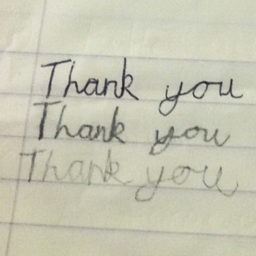 Child's handwriting saying Thank you.
