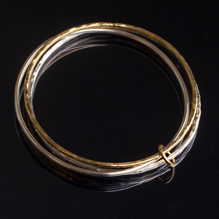 Gold and silver intertwined bangles