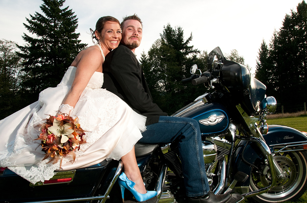 Wedding couple on motorbike