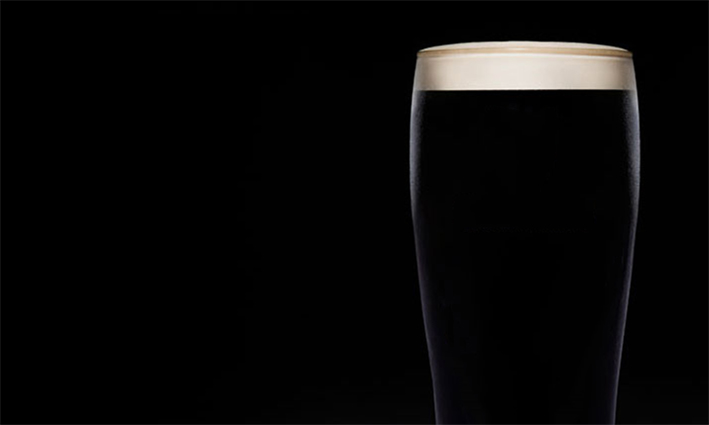INFLUENCING THE MOMENT OF DECISION MAKING    Consistent use of Guinness's black and white Primary Brand Asset in a venue's decision corridor triggers Guinness in the System 1 brain and increases the propensity of selecting Guinness when beer consumers reach the bar to order their first drink.