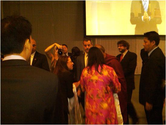 Carol shaking hands with the Dalai Lama