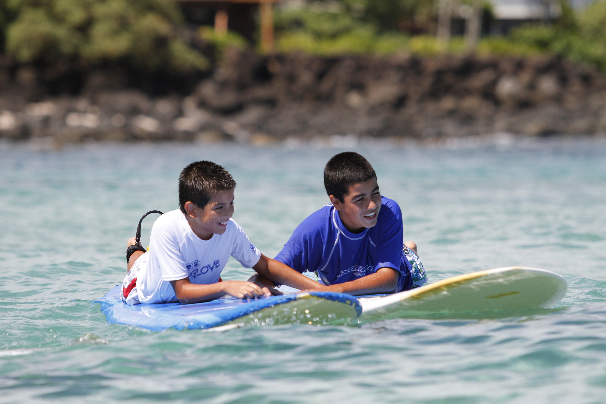 Catholic Surfing Ministries - Friends holding boards