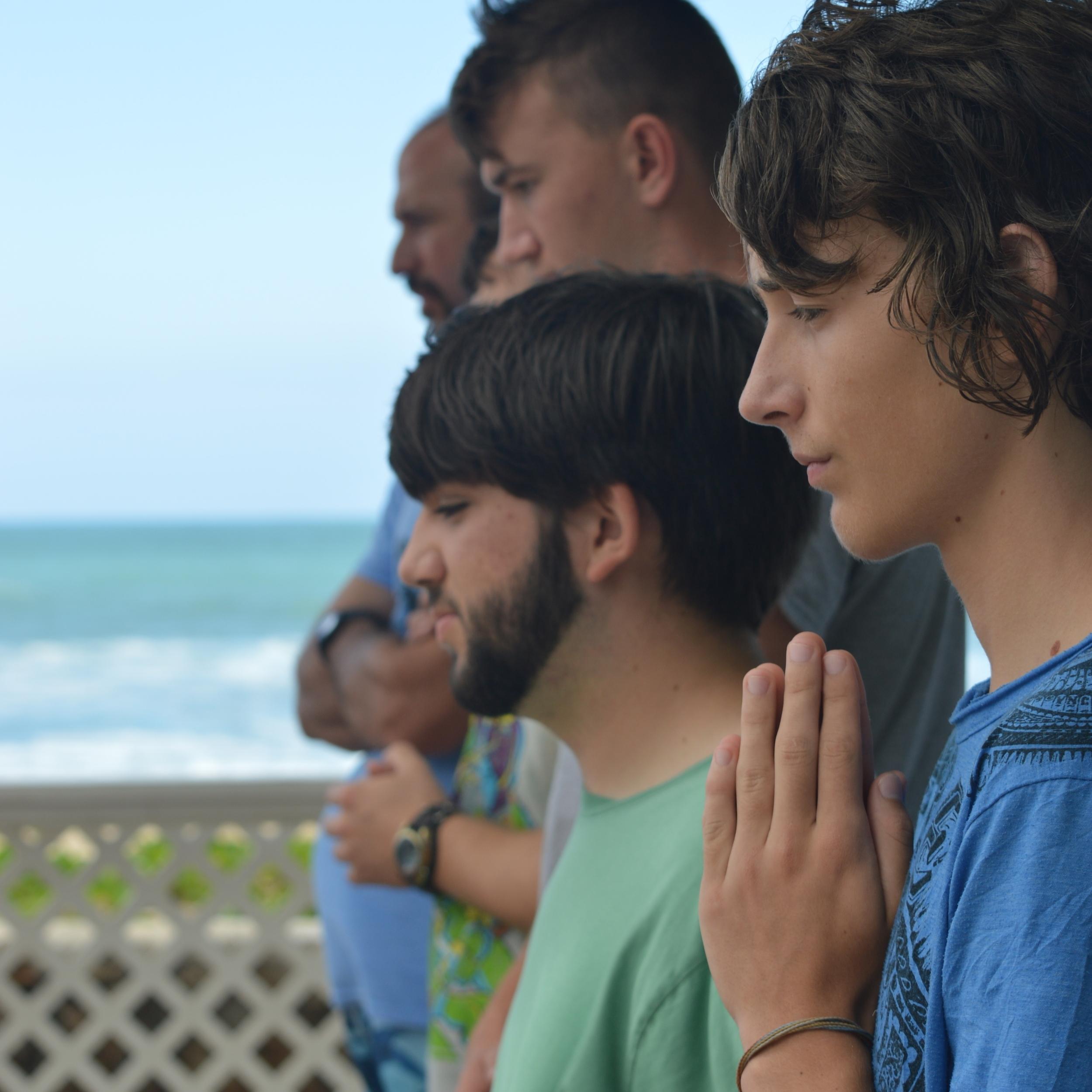 Catholic Surfing Ministries - Campers praying