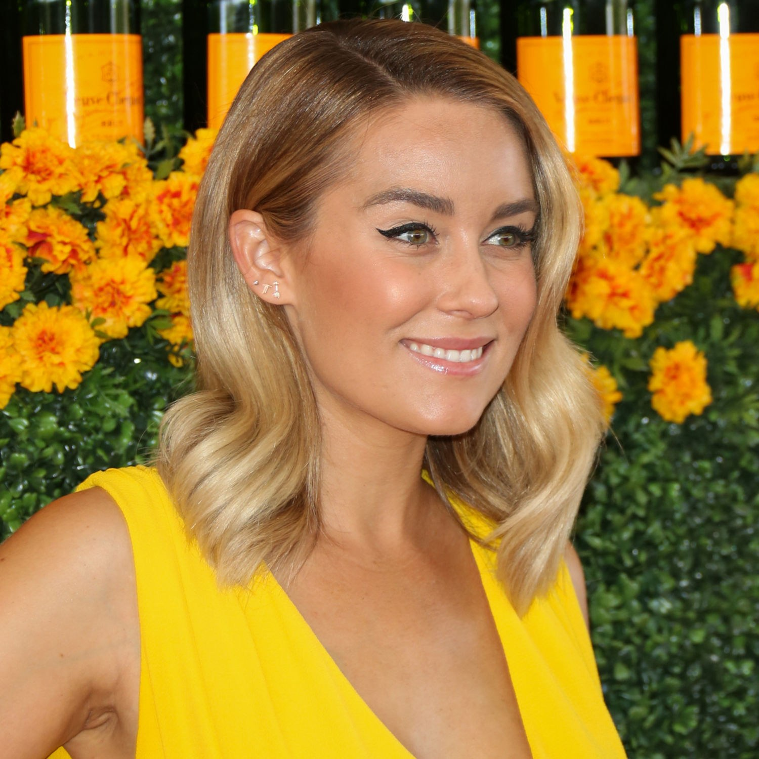 What is not to love about LC's style? Her fresh spring cut looks stellar is this casual smoothed out wave, which pairs amazing with her cat eye liner. I would wear this look to a gala or a casual evening wedding. Fun + simply stunning.