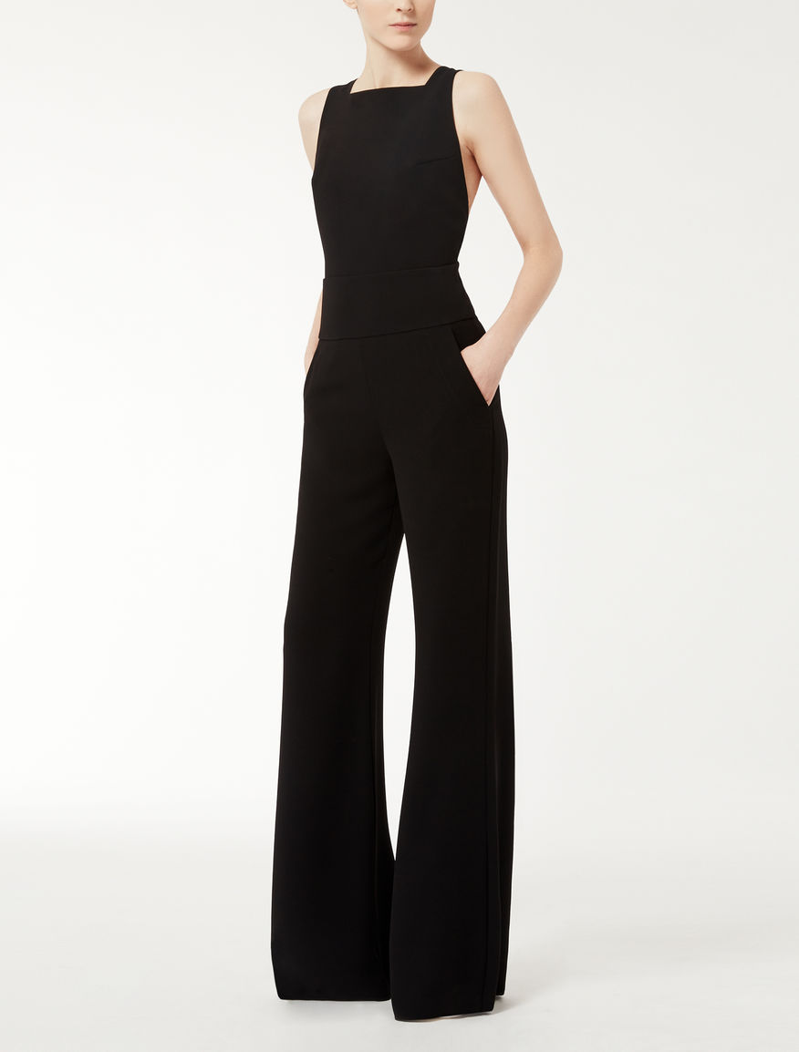 Instead of wearing that little black dress; switch it up and go for a fun jumpsuit. Jumpsuits are the stylish choice for a gala or evening casual wedding. You can find jumpsuits in bright colors and even backless. SEXY!Who says pants can't be fun.