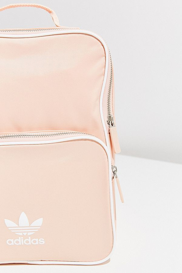 "Backpack - While on the ""treat yourself"" topic, this school essential is sure to be a great addition to your back to school haul. Urban Outfitters baby pink Adidas Original AdiColor Mini Backpack is perfect for any student."