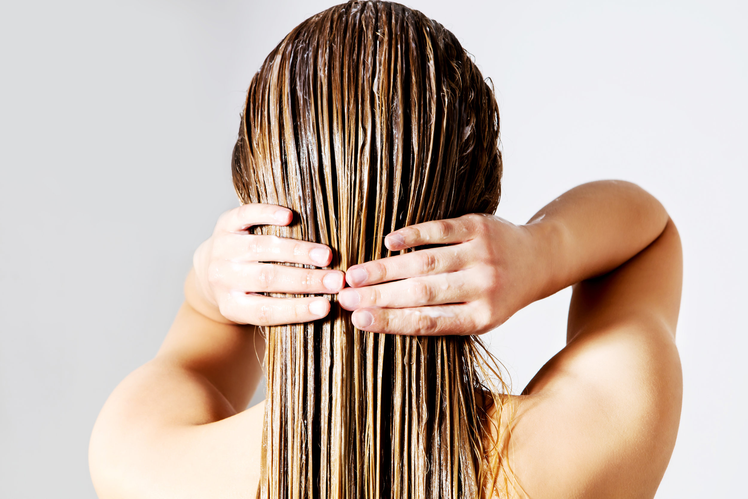 It starts in the shower - Using the right shampoo and conditioner is essential. We recommend pinpointing your main concern with your hair and selecting the products specific to helping you in that area.Use a professional product that is concentrated with quality ingredients such as Davines Oi shampoo which is perfect for anti-aging. Store-bought shampoos tend to have more water, sulfates, and fillers with fewer vitamins, oils, and minerals than salon formulations.