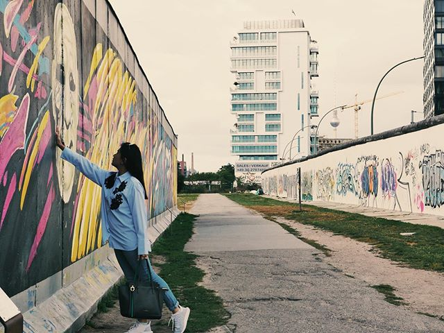 Throwback to our Berlin trip because most our friends are there for the International! 👋🏼 Notes from our blog: This could be one of the most memorable strolls you'll ever take in your life. What was once part of the Berlin Wall is now a 1,316-meter stretch of murals and paintings. This historic work of art is considered an international memorial for freedom. Get your hearts and cameras ready. (I like that I just quoted myself LOL 🤪) . . . . . . #nowthatsahoneymoon #heyitsthewongs #travelphoto #relationshipgoals #dametraveler #traveltogether #travelmore #visualsoflife #bestvacations #placesaroundearth #forbesttravelguide #travelguide #doyoutravel #travelguide #instatravel #fantastic_earth #travel #couplestravel #wanderlust #travelgoals #coupleswhotravel #germany #berlin #summer #berlinwall #europe #visitberlin #travelshots #bucketlist