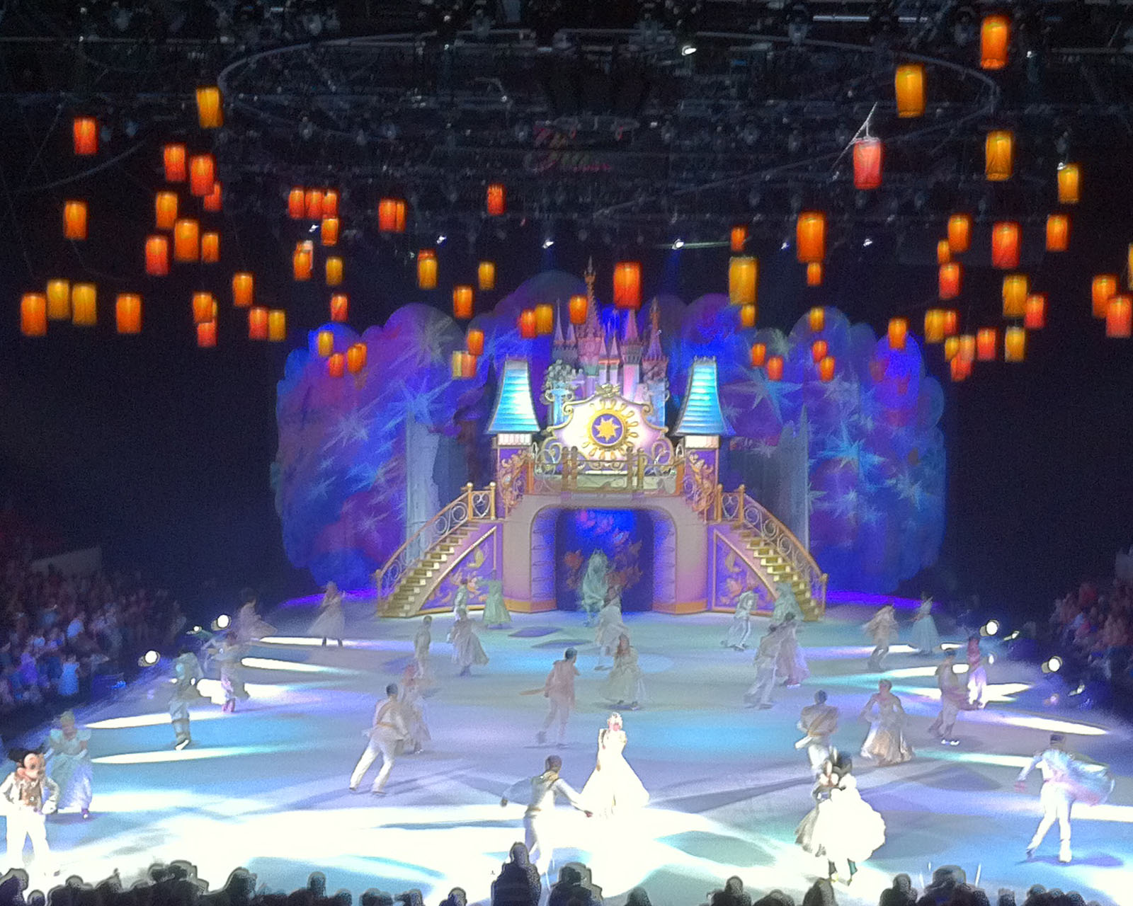 Stairs on the castle open up and lanterns waft across the sky above the ice for the big finale.