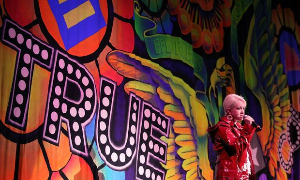 Cyndi Lauper in front of the True Colors politically-inspired show drop.