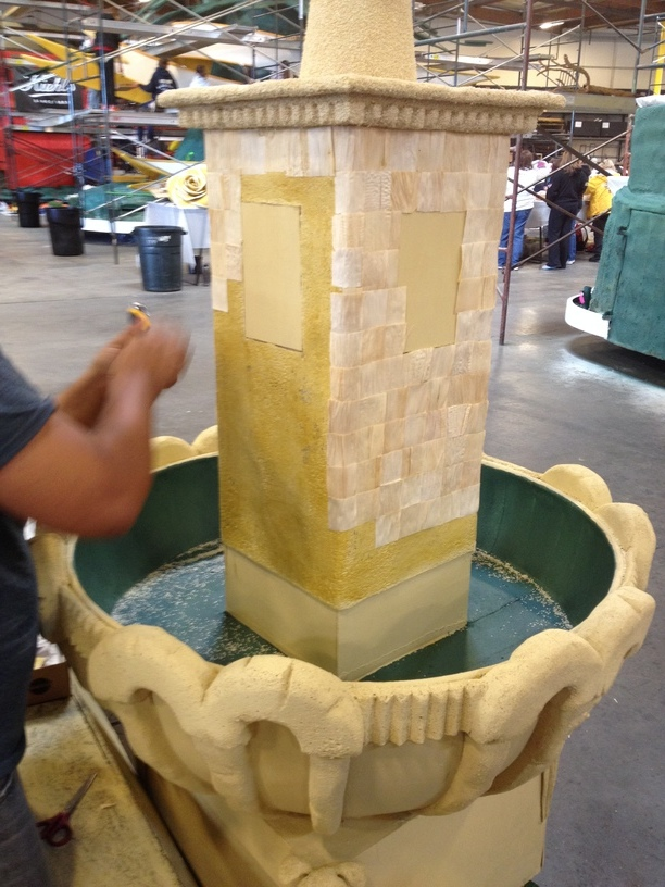 The fountain being covered in corn husks.