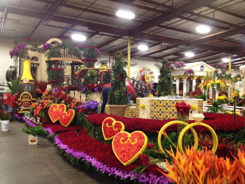 Floral designers finishing up the float at 3 am before the morning judging session.
