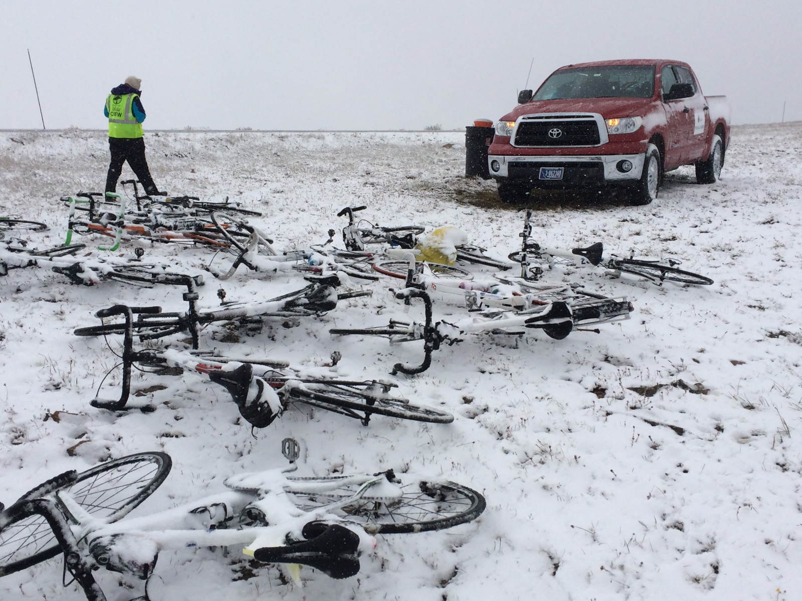 Crew member supporting bikes from those who did not make it over the Beartooth Pass in 2015.