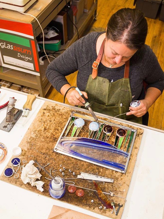 Katie Sisum working in her studio.