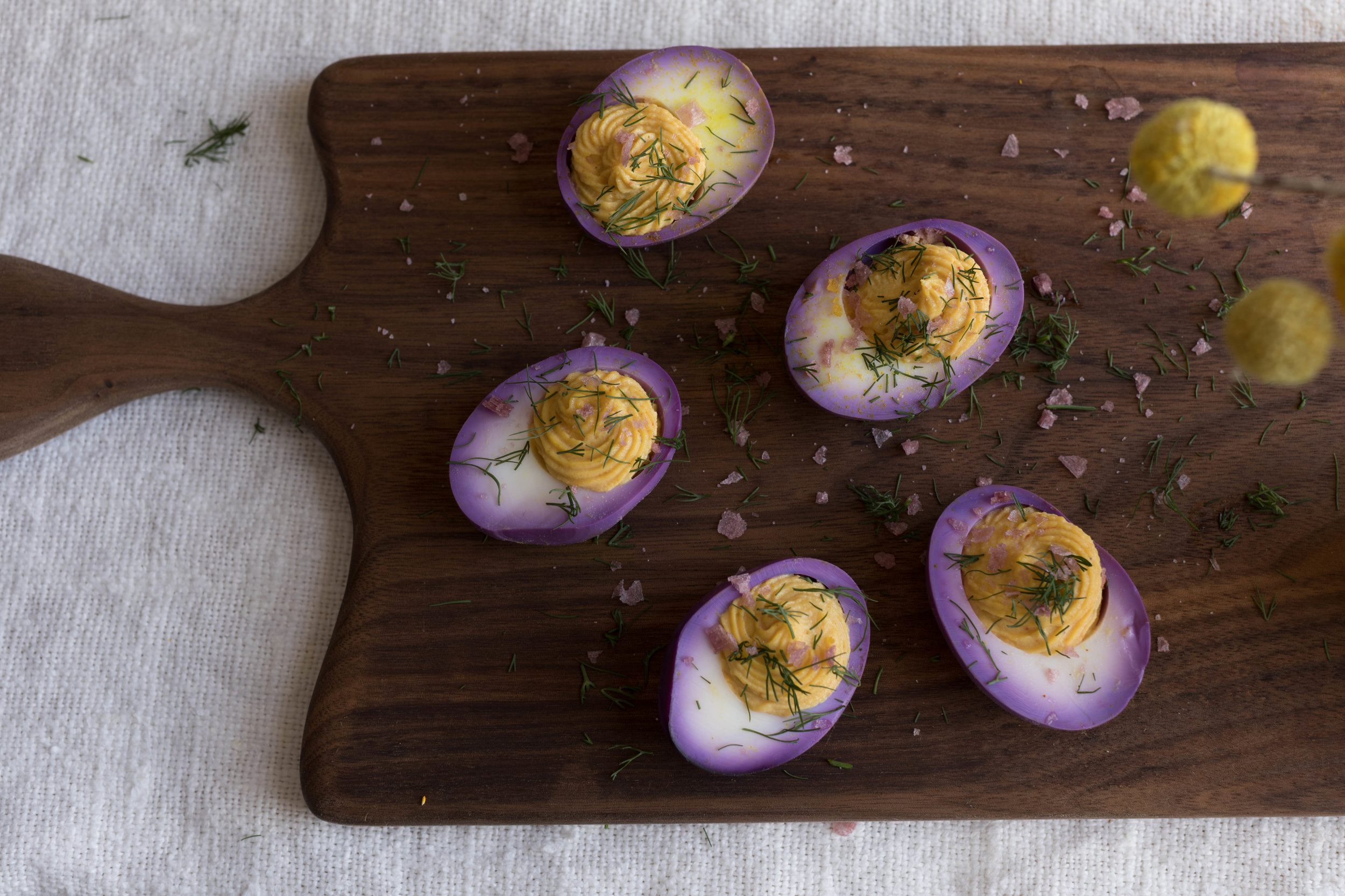 cabbage pickled deviled eggs 🥚Beautiful walnut board by  Annie Meyer .