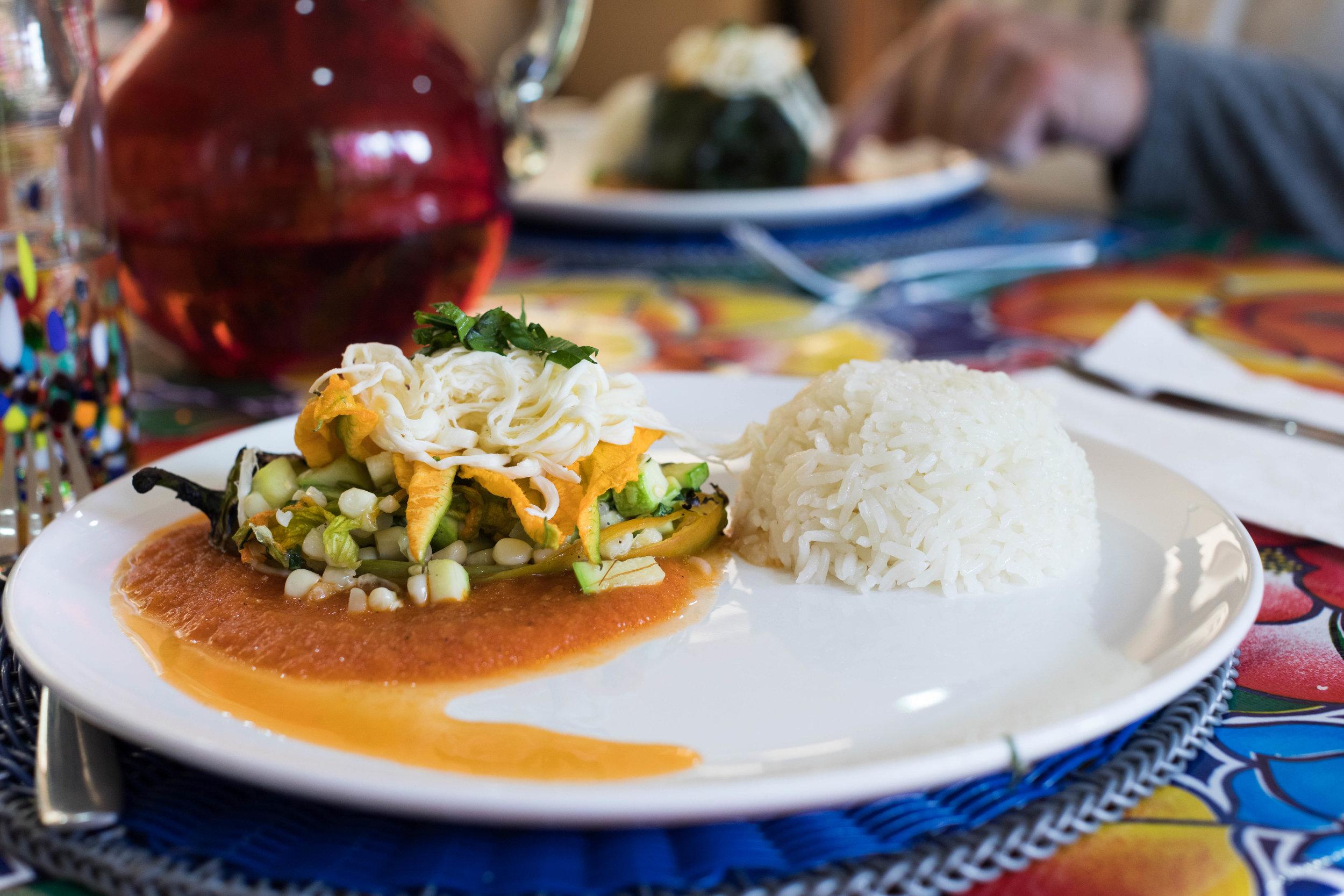 The more authentic, spicier chile relleno de flor de calabaza y queso con salsa roja!