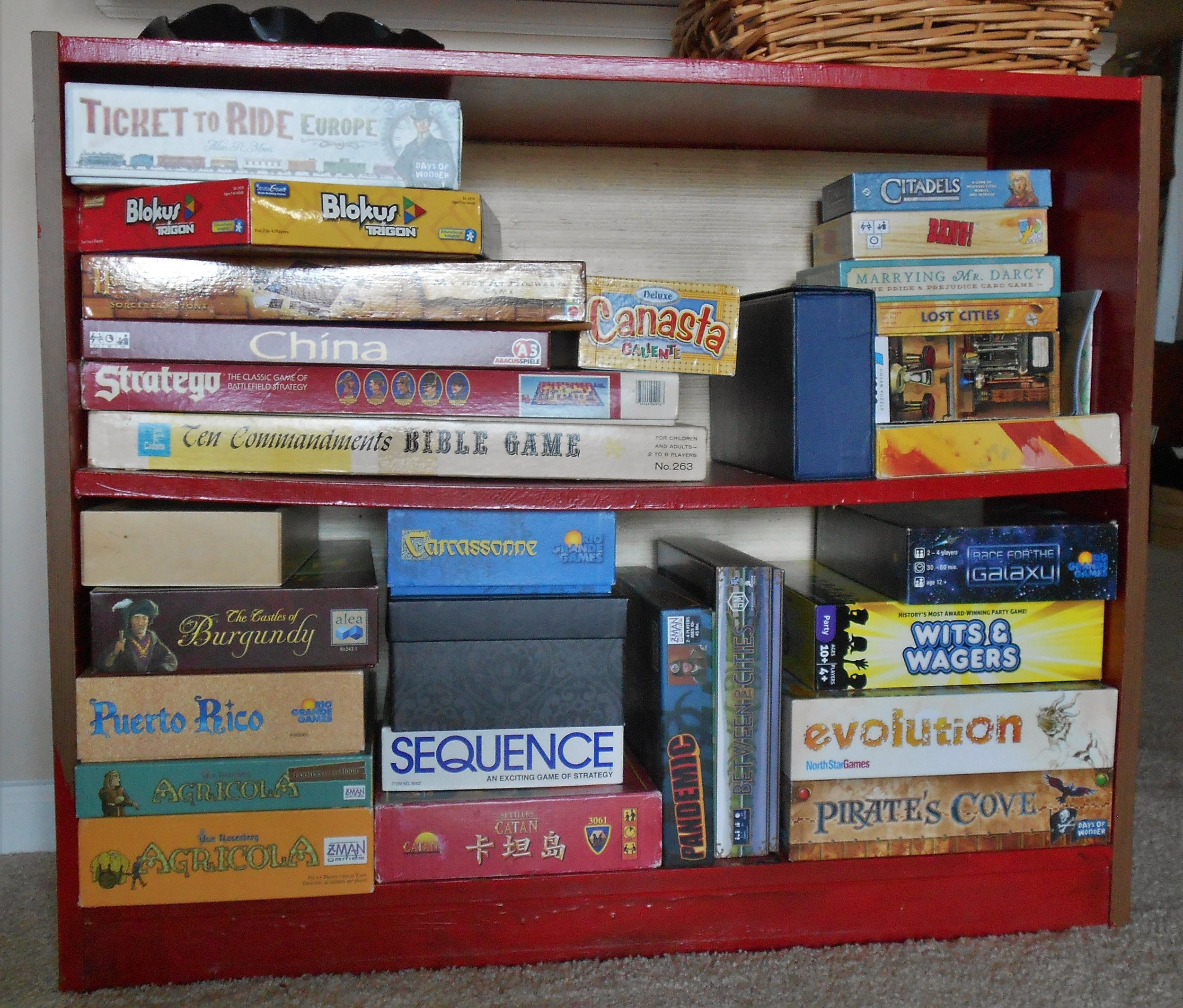 Our current board game collection (recently edited). In 2011, a coworker randomly handed down Carcassonne to Kate a few weeks before we got married. We took the game with us on our honeymoon and obsessively played at least once a day. We've never looked back.