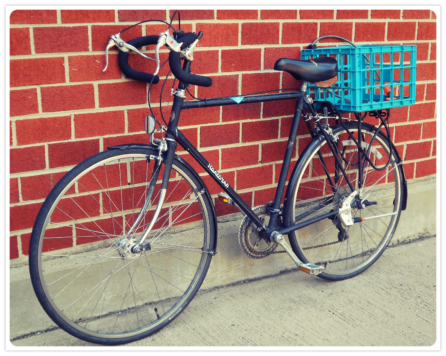 I think the teal milk crate really gives the bike a certain roguish charm.