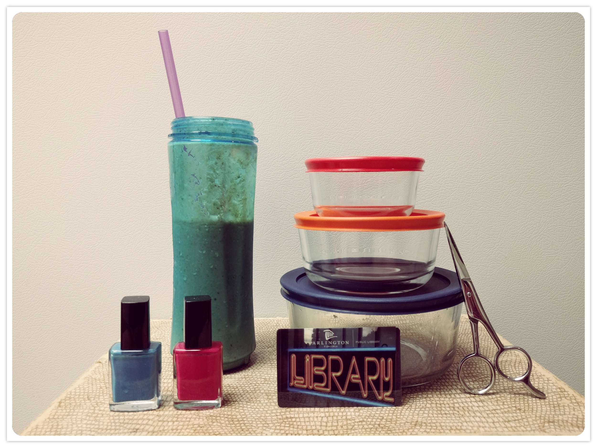 The tools of my frugality: homemade smoothie from a ready-made freezer pack, nail polish for DIY manicures, reusable lunch containers, hair-cutting scissors, and my handy dandy library card.
