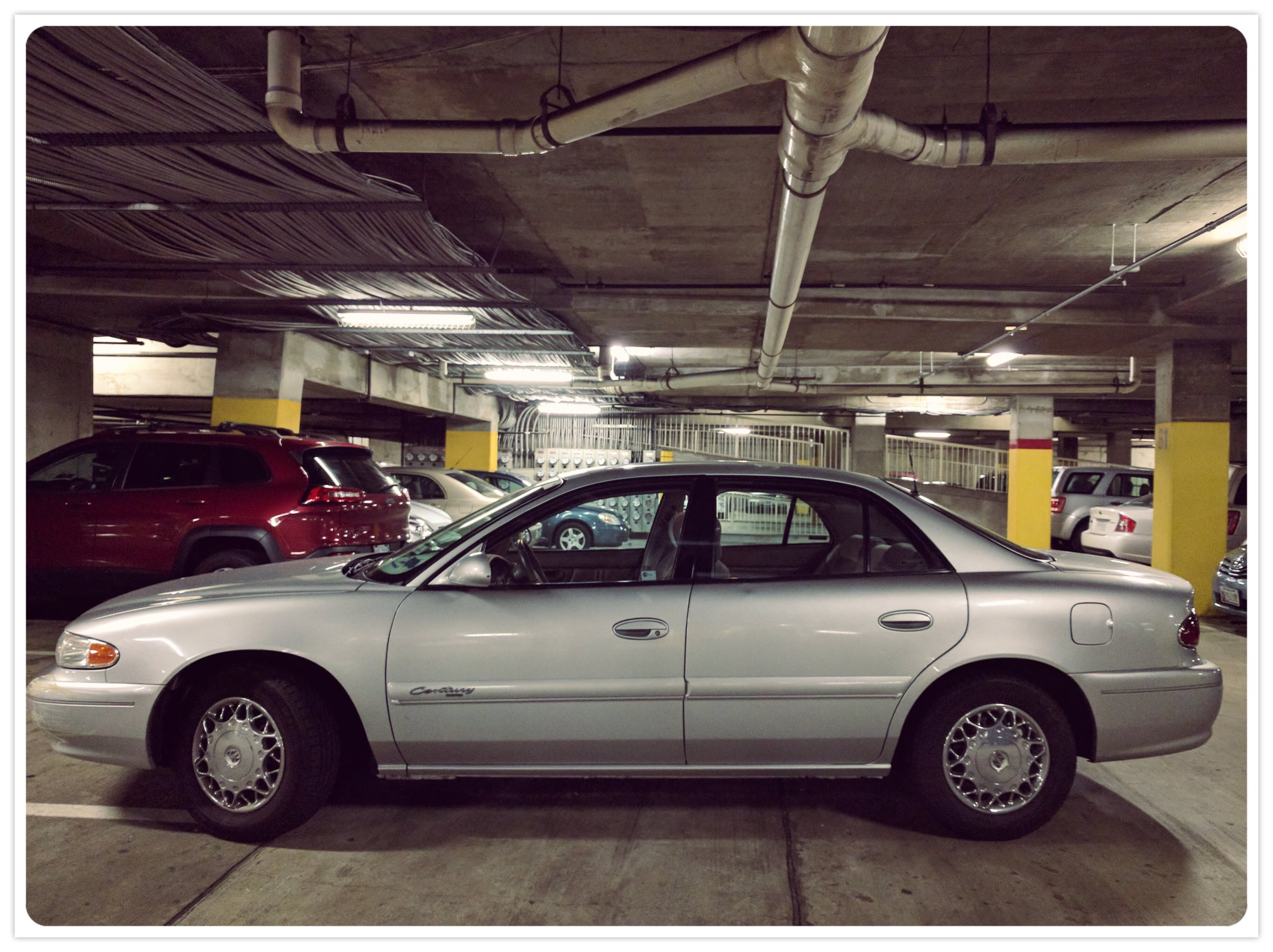 I know it looks like a LeSabre...but it's a Century! And it really adds some class to our parking garage.