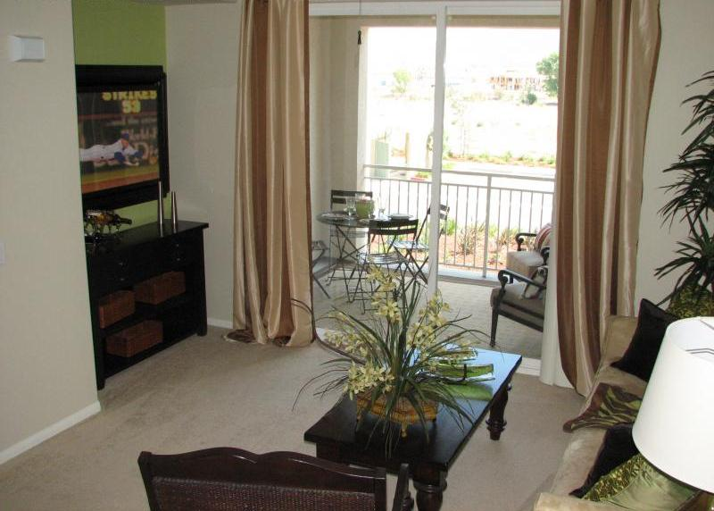 Living area looking out towards balcony at Temecula Creek Villas