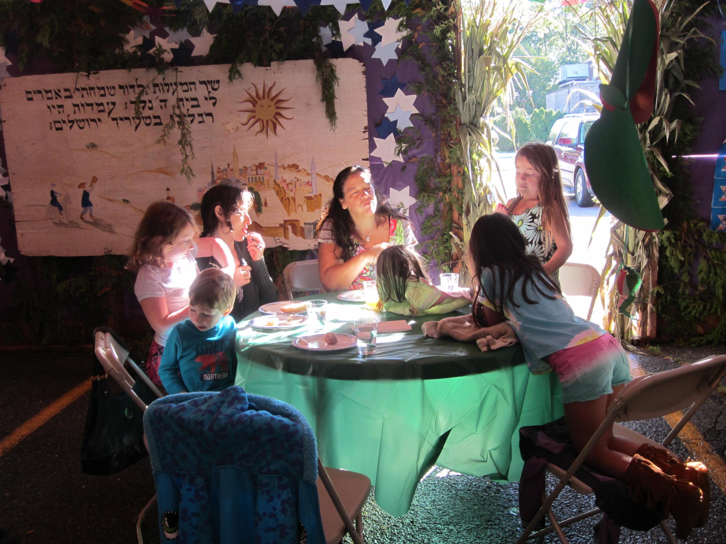 students in sukkah 2.JPG