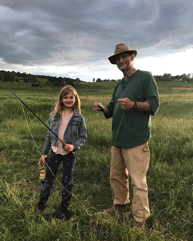 Randy is showing a young guest how to fly fish @cedaridgeranch. #glamping #fishing  #sustainabletourism