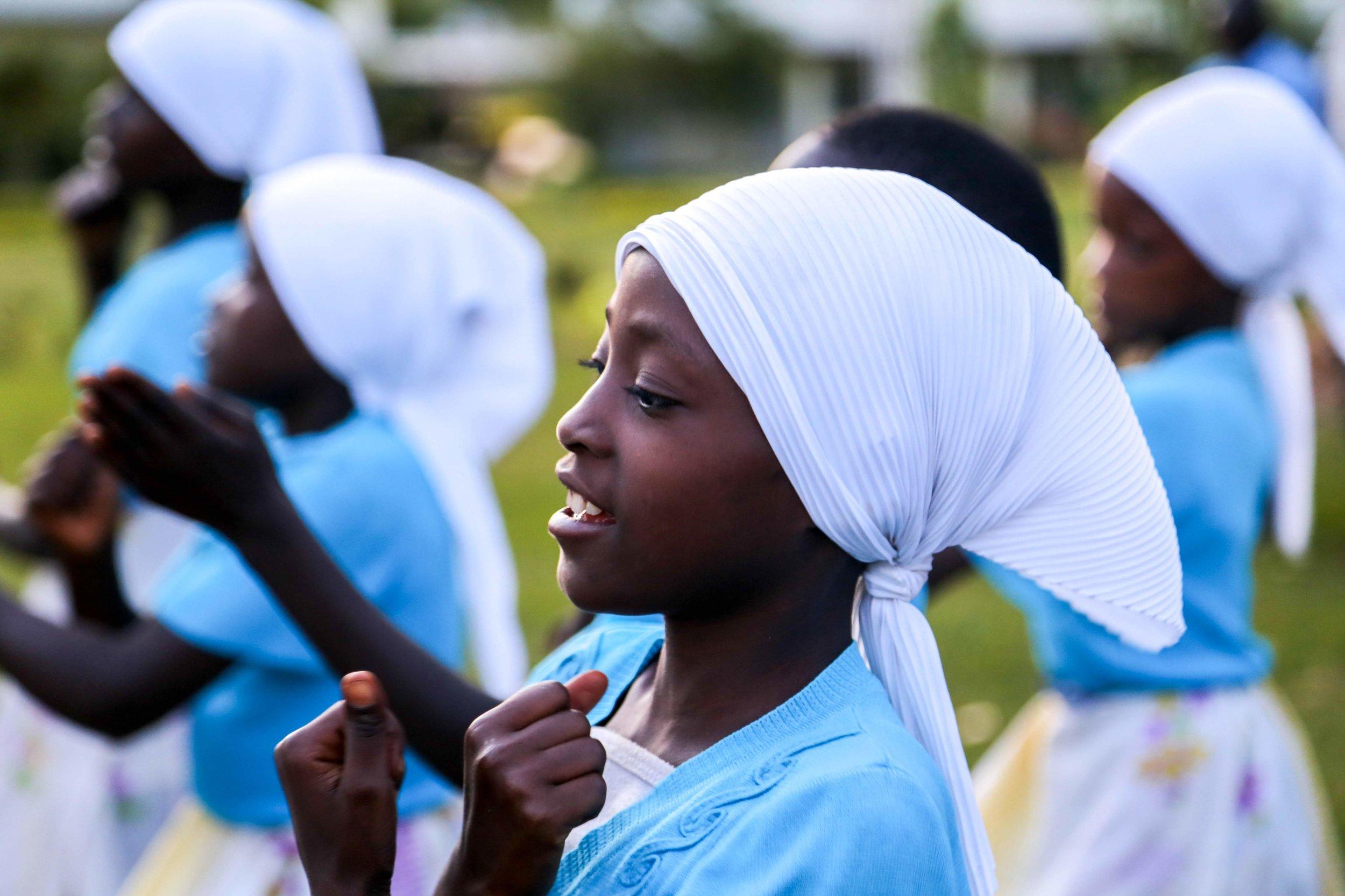 child in white headscarf (1).jpg