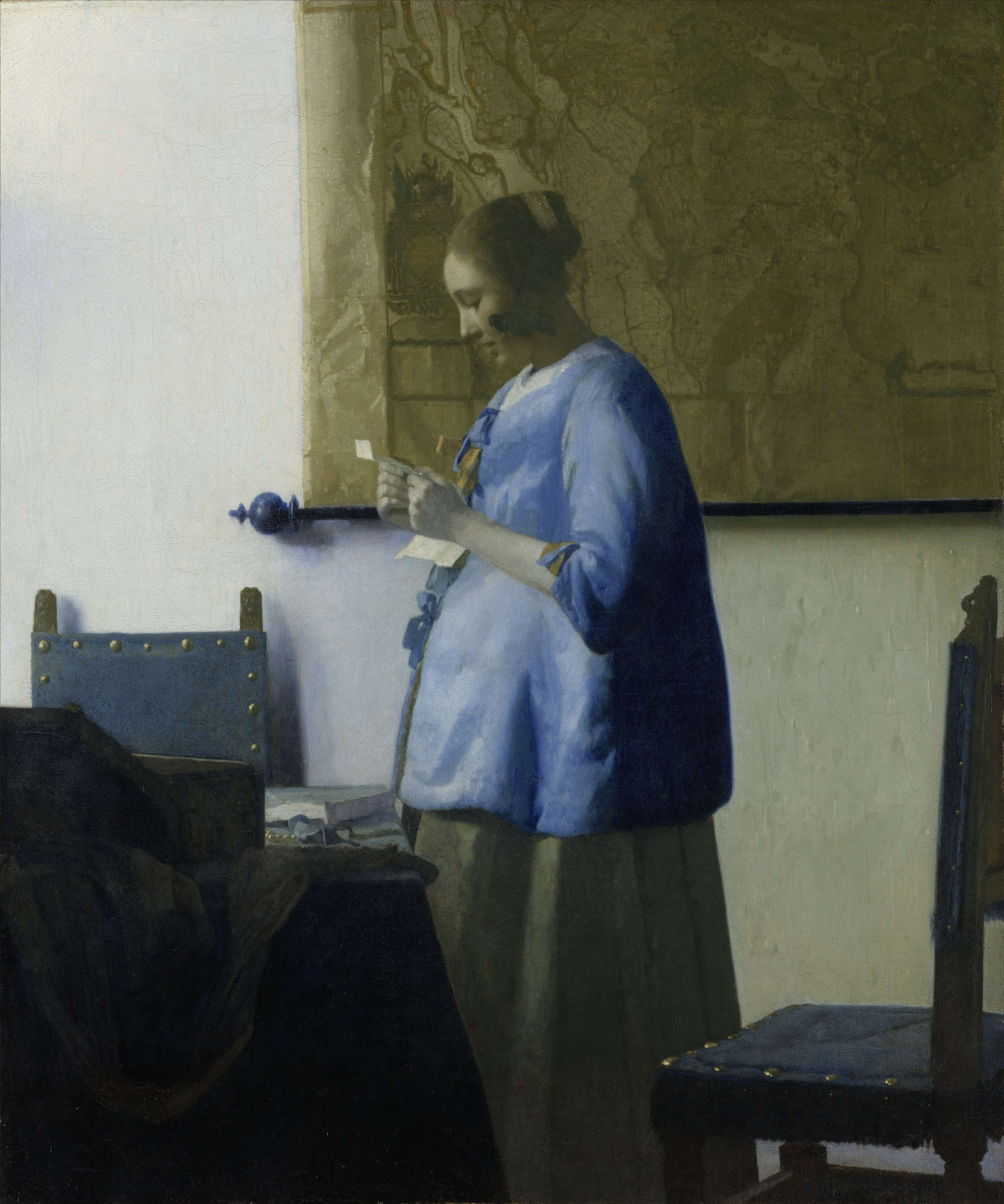 [Woman in Blue Reading a Letter by Jan Vermeer]