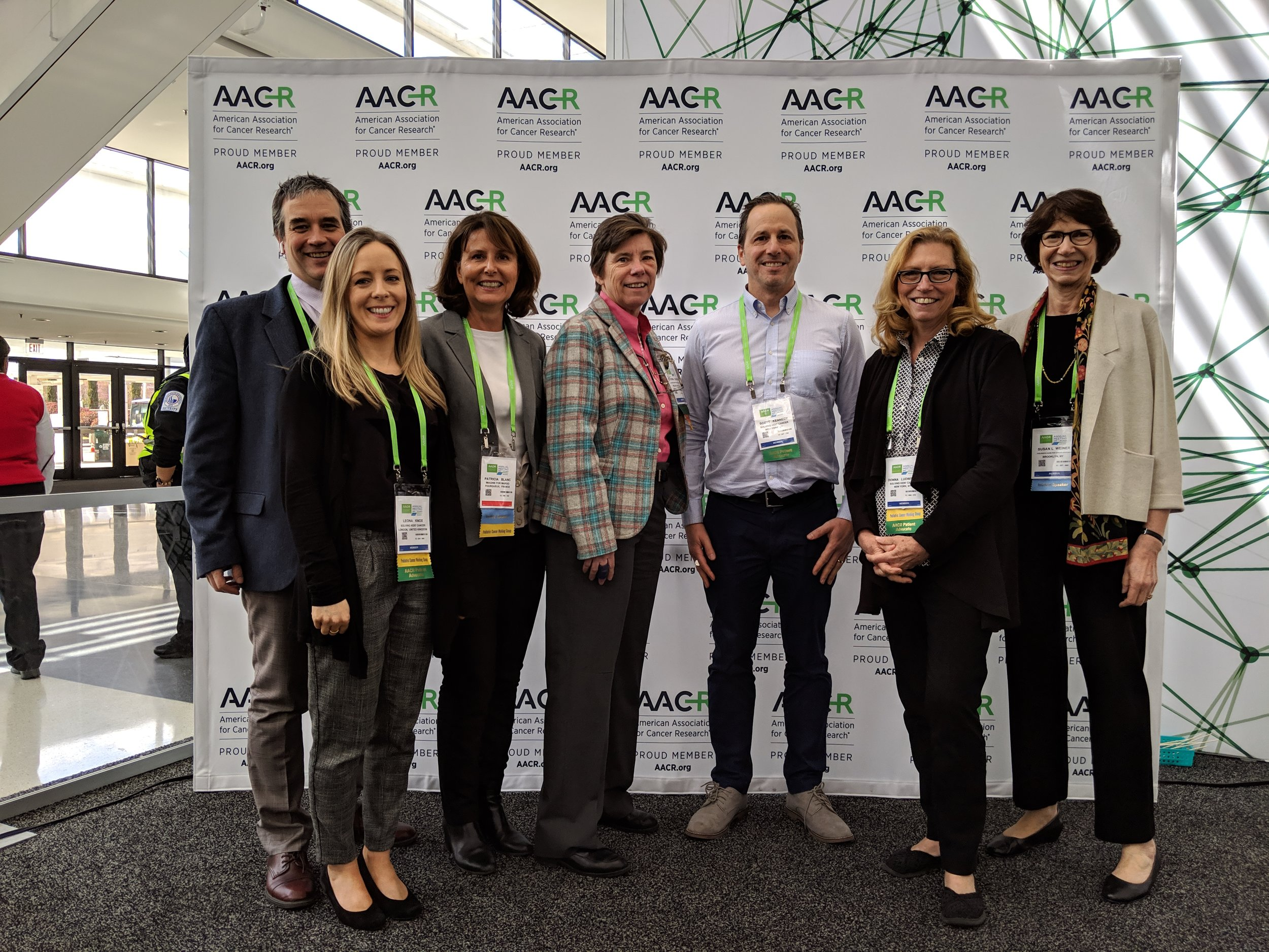 Photo: Childhood cancer advocates gather at the 2019 American Association for Cancer Research. At far right is CCCA's founder Susan L. Weiner, PhD.