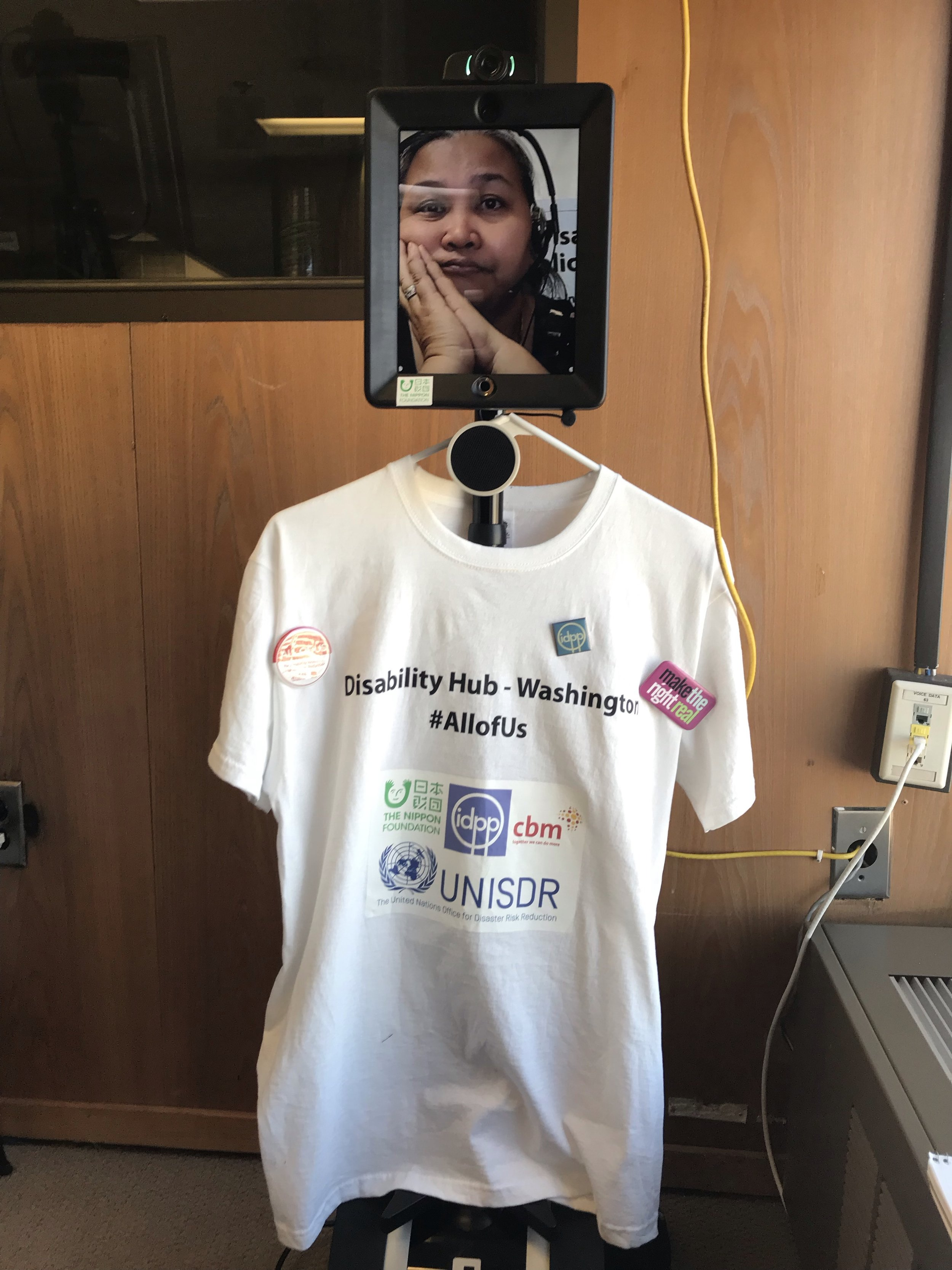 "Pictured (above): IDPP Program Associate Della Leonor using ""Ally,"" IDPP's telepresence robot, to participate remotely at the INGRID-H launch."