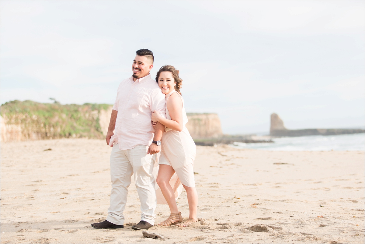 Engagement photo shoot at Four Mile Beach in Santa Cruz, CA. Pictures by Briana Calderon Photography based in the San Francisco Bay Area in California.