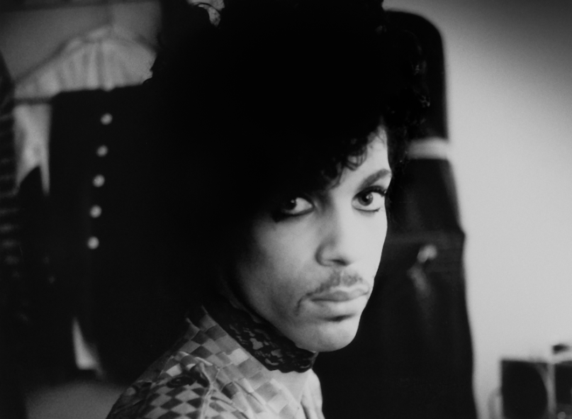 prince-piano-a-microphone-1983-black-and-white-the-prince-estate-allen-beaulieu.png