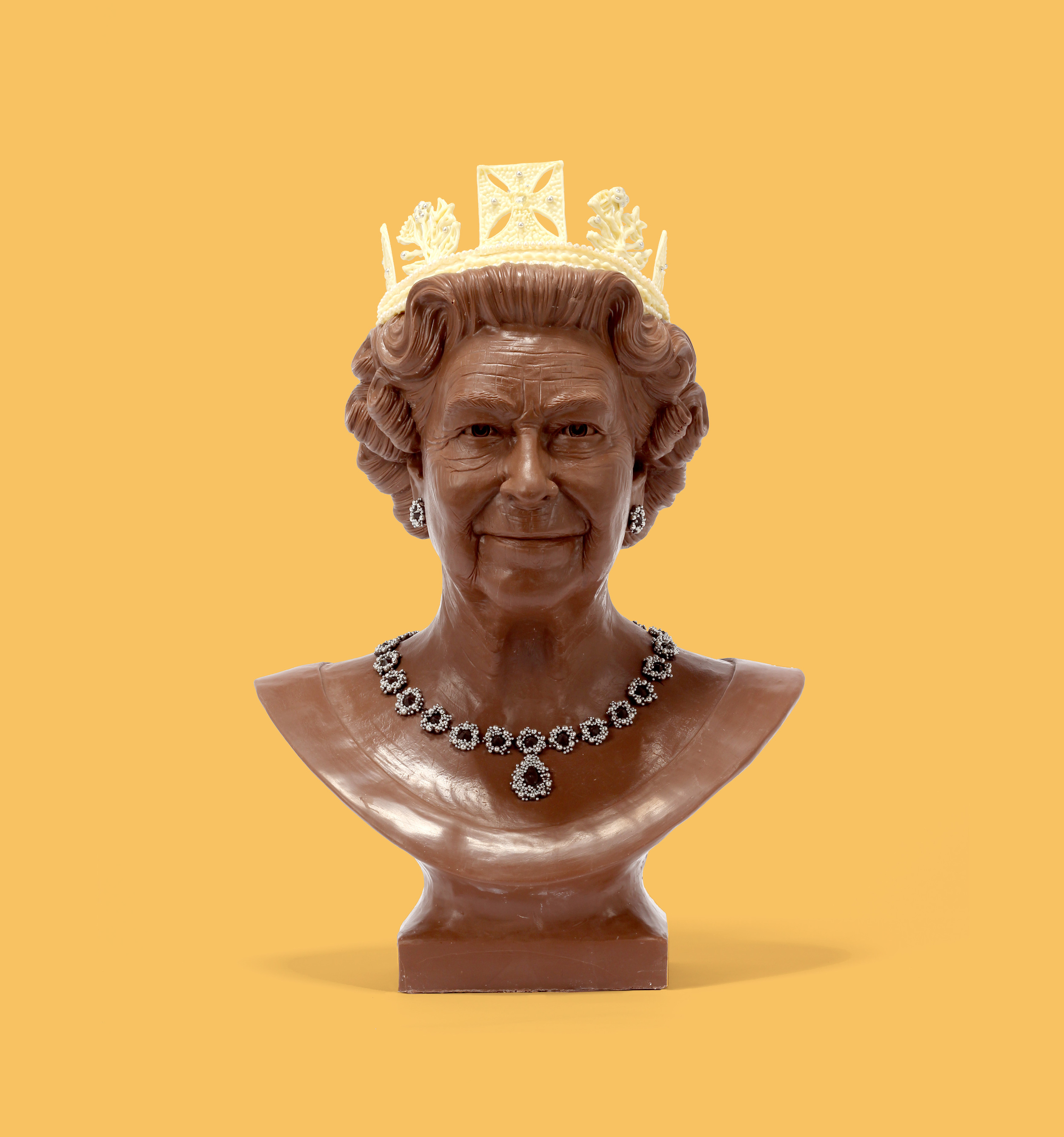 Milk chocolate Queen Elizabeth ll adorned with white chocolate diamond diadem crown and silver dragee jewels.