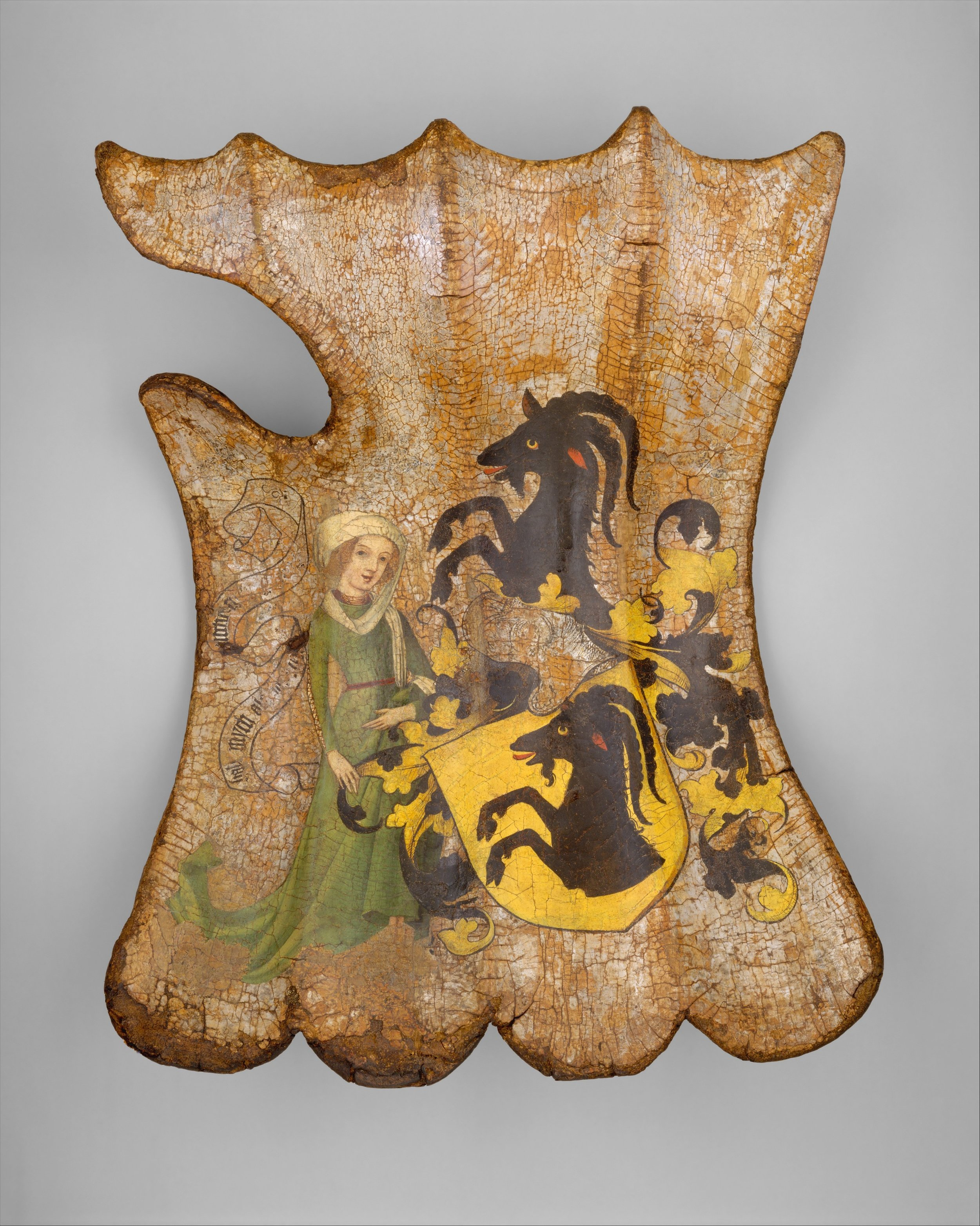Shield for the Field or Tournament (Targe) ca. 1450 ,  German, Wood, leather, linen, gesso, pigments, silver, H. 22 in. (55.88 cm); W. 16 in. (40.64 cm), Gift of Mrs. Florence Blumenthal, 1925, Accession Number : 25.26.1  Click    here    to view on the Museum's website