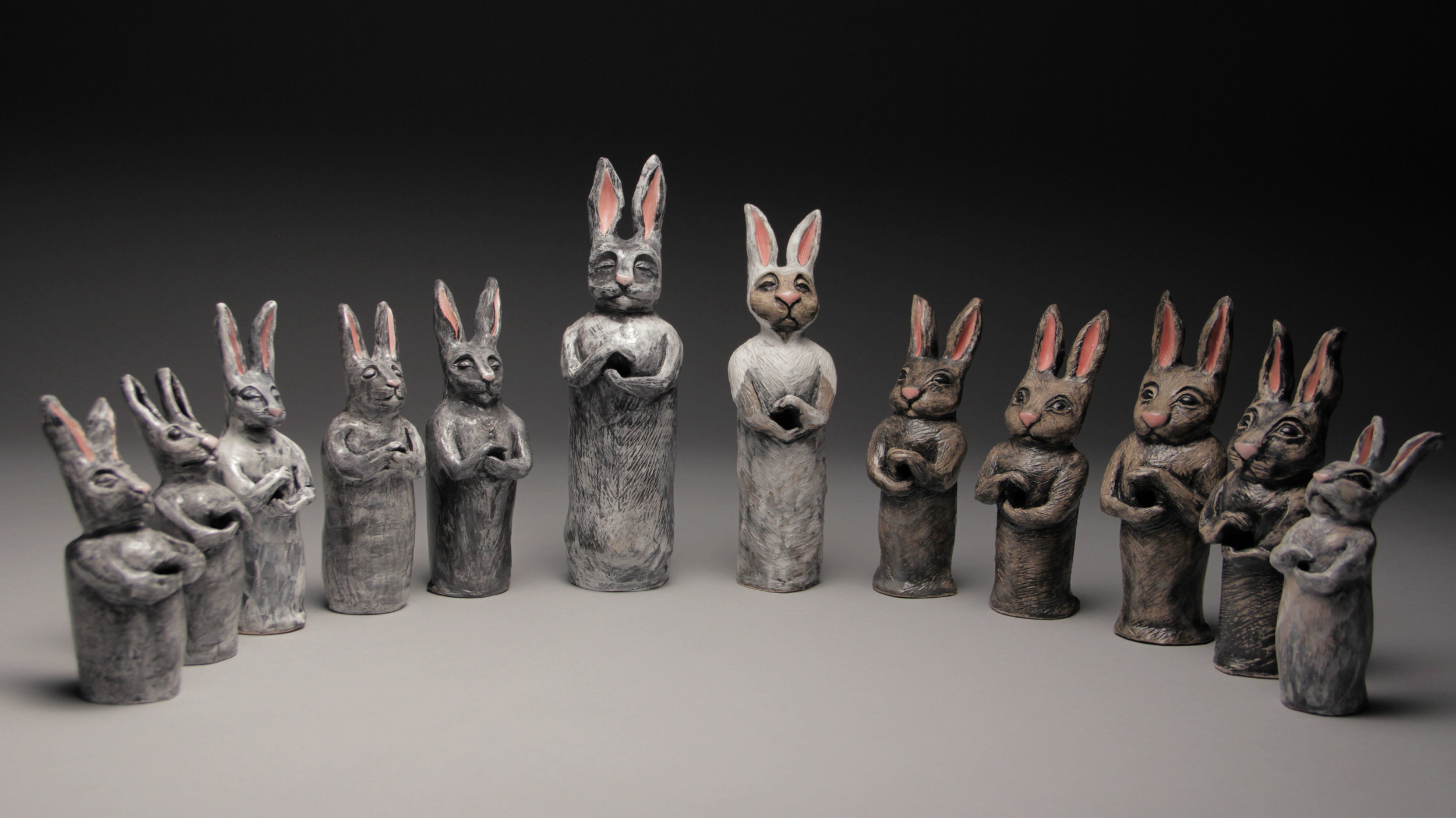 """More versions of my votive rabbits. """"The Wedding Party"""" These are freestanding clay sculptures that also function as incense burners."""