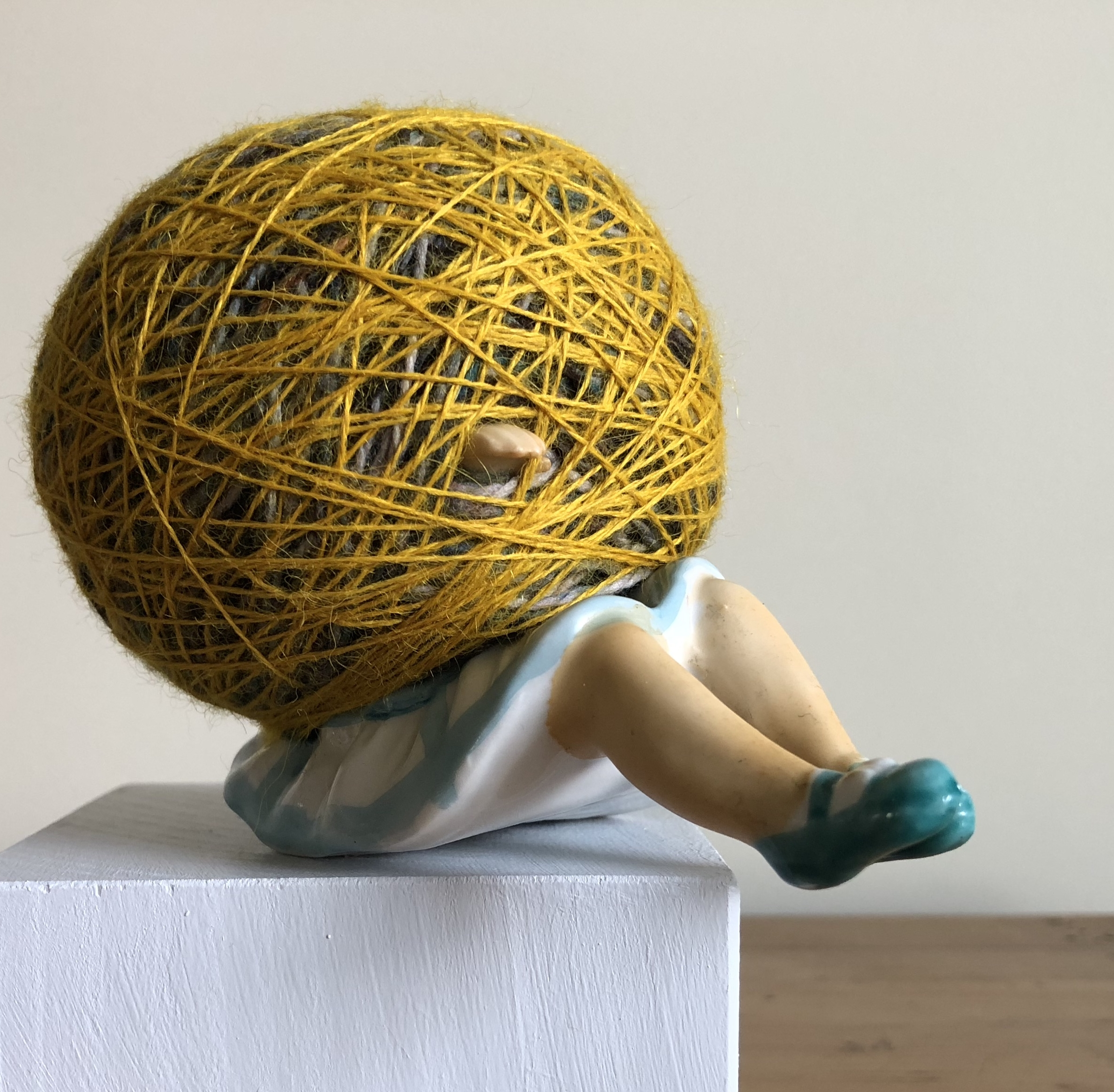 REACHING EQUILIBRIUM, 4x5x3.25 in., found ceramic figurine, wool, linen and cotton threads - 2018