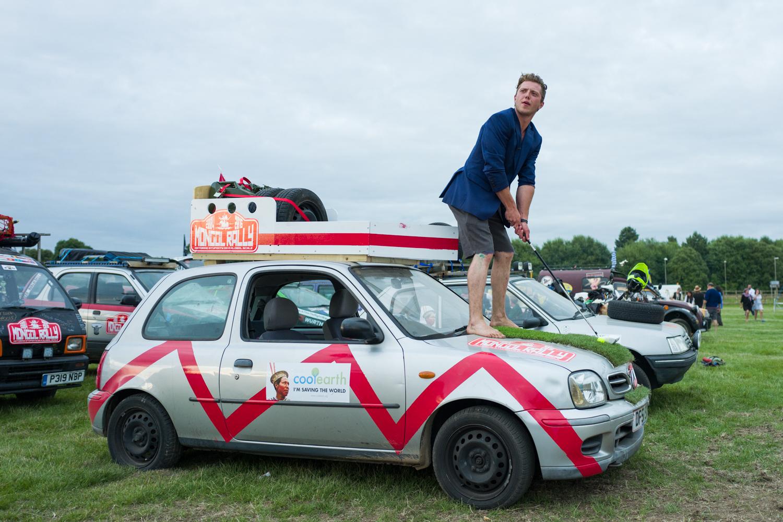 Rallier Liam Thorpe, putting golf balls off his car's hood