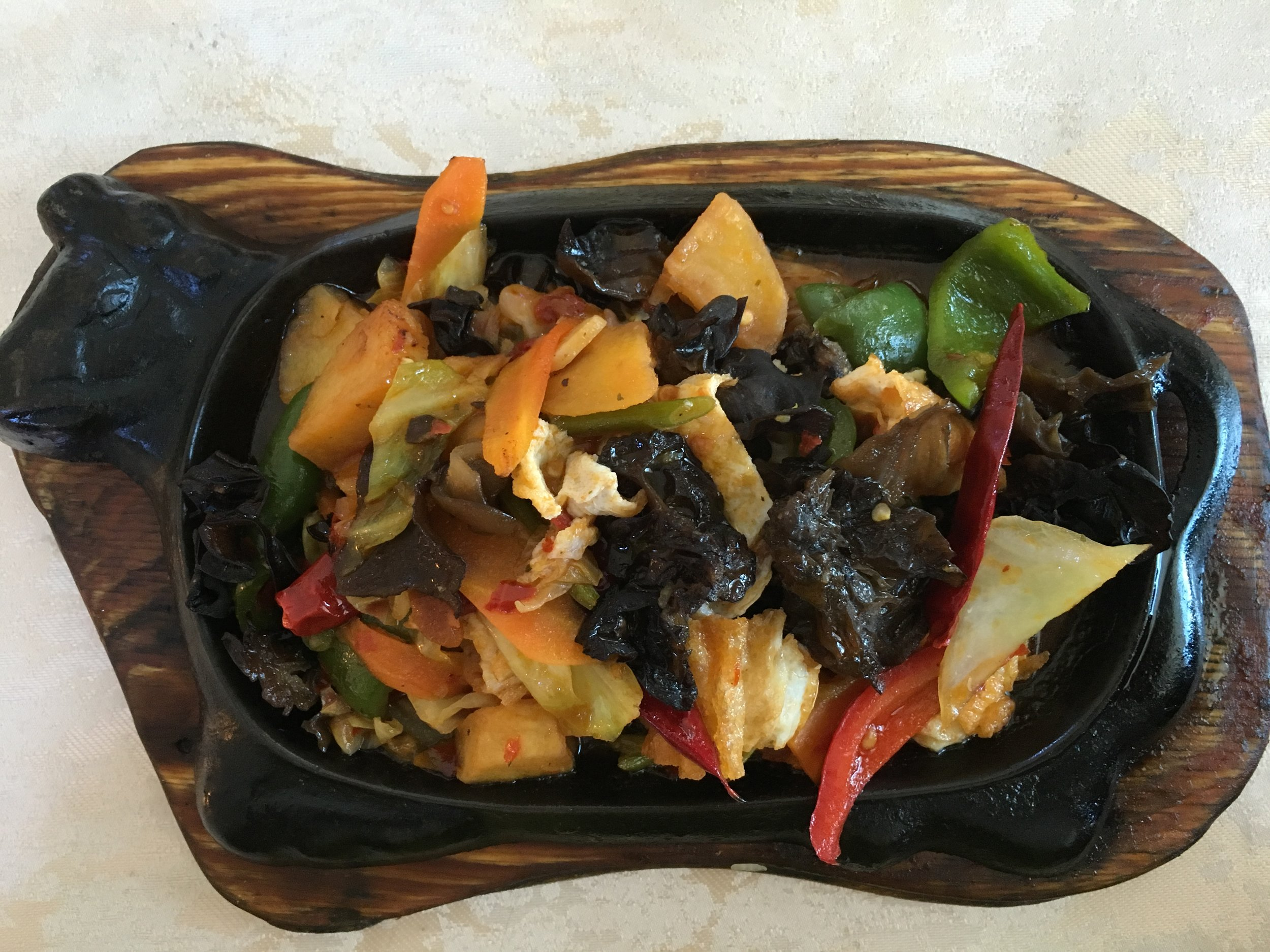 Delicious vegetarian dish of sizzling peppers and mushrooms