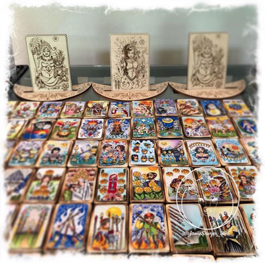"Tarot Tiles and all the other stuff - If you're familiar with me and my work, then you know my busy brain is constantly creating.In addition to the Tarot and Lenormand Decks, I also make miniature versions of my decks, cast in resin on wood. Affectionally referred to as ""Tarot Tiles"". They are one off sets and take me a while to make, available in my Etsy shop updates. I also make wooden engraved versions of my cards for Altar tools and divination boards. Visit my shop to see what new offerings I have in store for you!"
