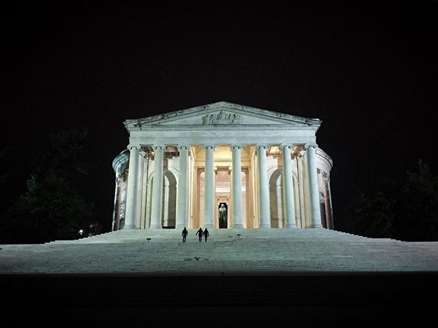 The night rests. The sky is empty, no clouds to catch the light. Buildings rise as beacons, all lit with memory. One raccoon has come up with the tide. A glint of fur against the blackness, he fiddles the leaves, unwary of history. Jefferson's Memorial is round, like the dome of the mind, so exalted. This stone rolled over tomb is not meant to shut ideas. The cold marble waits where a visitor might sit, only a little while, to press hands on old geometry. (TBT)