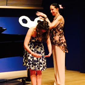 "Christina performing ""Les oiseux dans la charmille"" from Les Contes d'Hoffmann, July 2015. Audience member Meche Kroop winds the doll back up!"