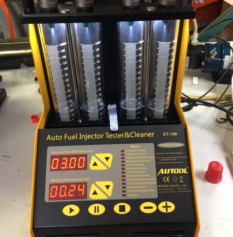 Injector calibration system