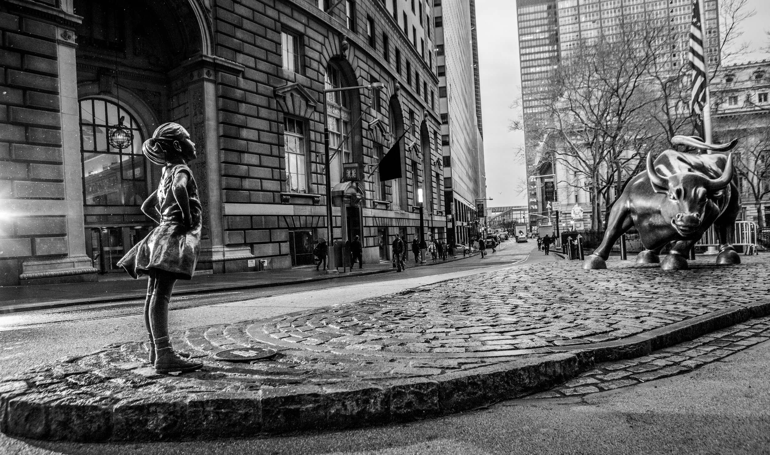"""""""In honor of International Women's Day, we are very proud to introduce """"The Fearless Girl""""- a statue of a daring young girl, standing strong in front of the bull on Wall Street. The statue supports the fact that companies with women in leadership perform better. The Fearless Girl is a symbol of the power of female leadership both today and tomorrow. This initiative has been a heroic effort in partnership between State Street and McCann. #FearlessGirl"""" - McCann New York"""
