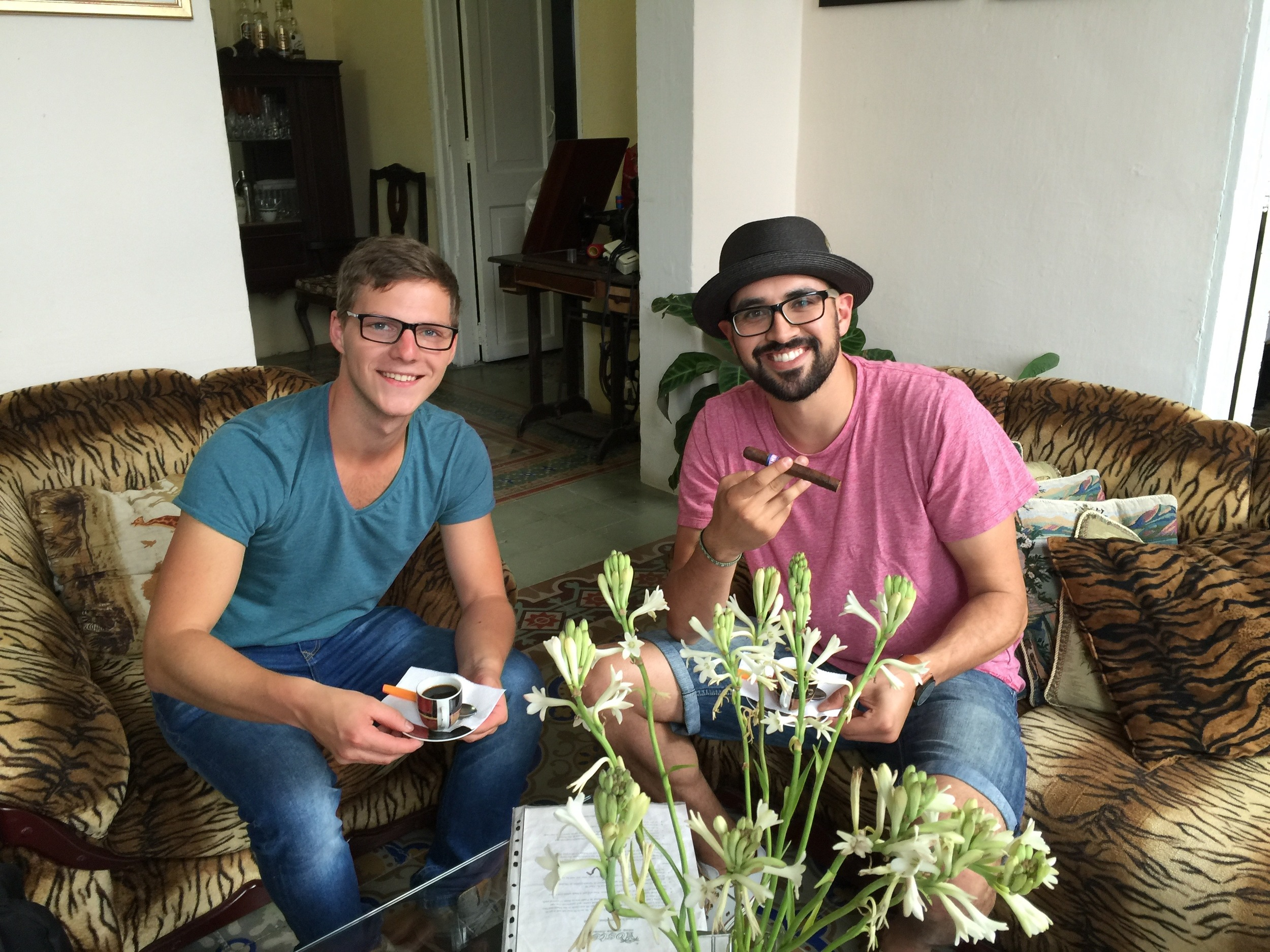 My German friend Manuel and I enjoying our first Cuban coffee and cigar at our hostel in Havana.
