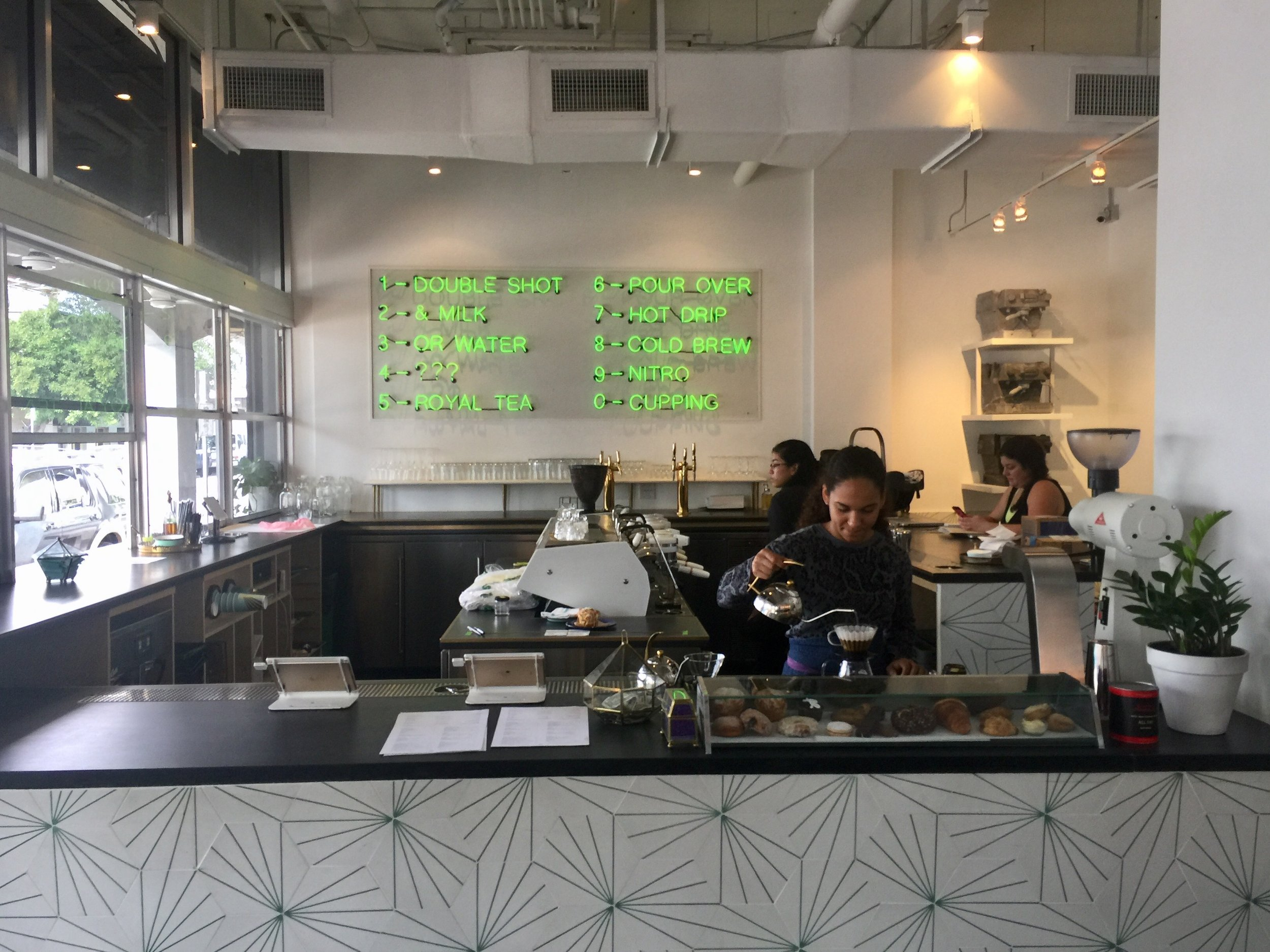All Day's neon green menu has become a focal point of Miami's burgeoning coffee scene.