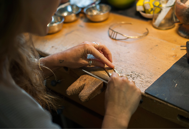 Nettie Kent in her Greenpoint studio, crafting jewelry. Photography by Filipa Alves.