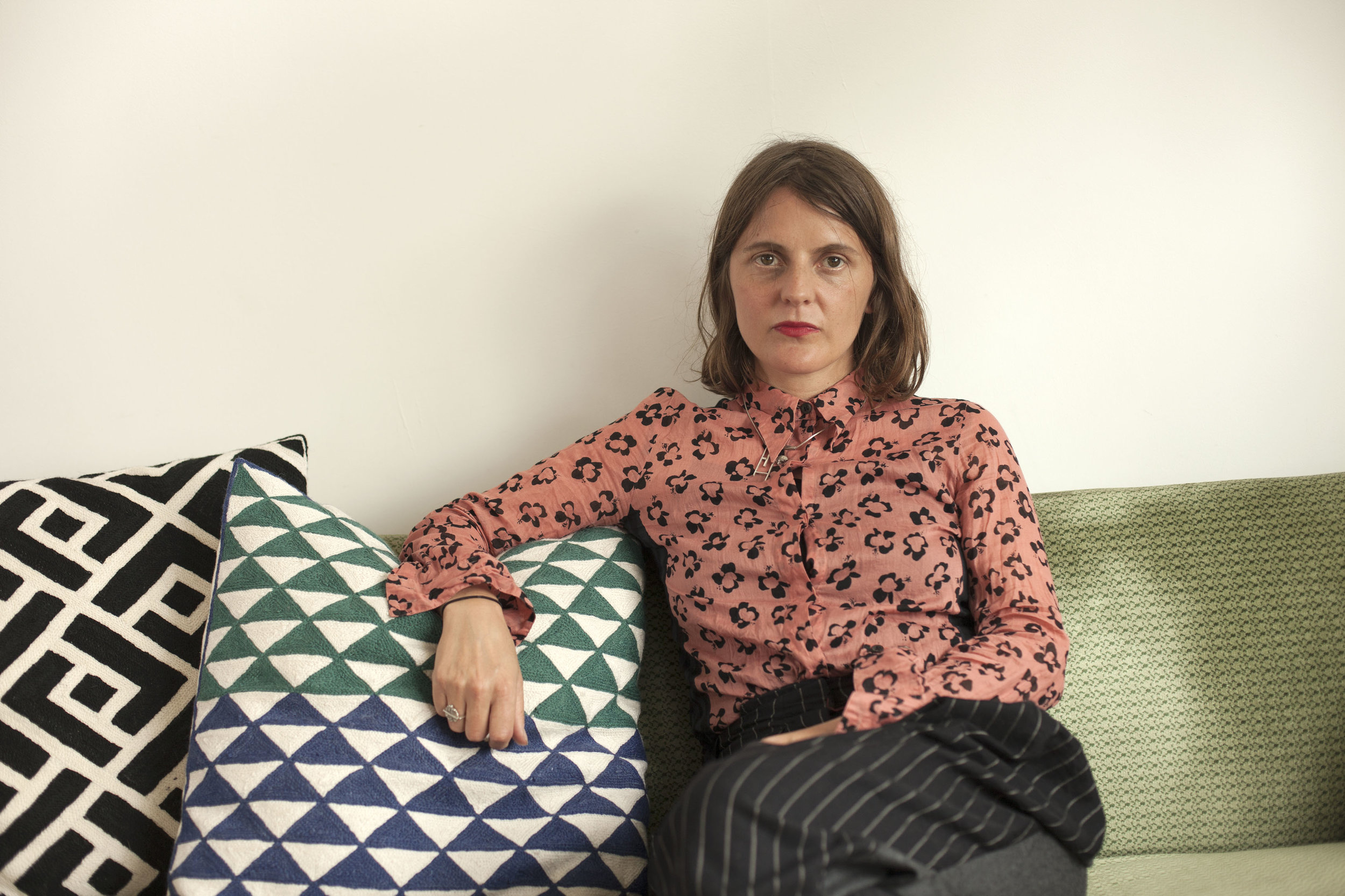 Noemi wears a pair of trousers by Stella McCartney, a Dries van Noten shirt, and her own jewelery.