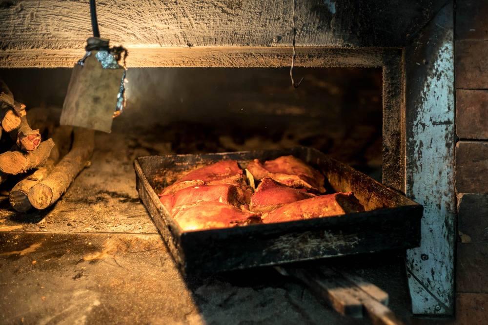 Lechon Pugon (brick-oven baked pork belly)